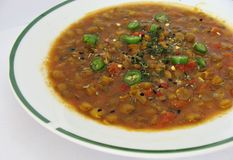 Indian Lentil and Tomato Soup. Green Lentil Soup with Indian Spices and Chilies Stock Image