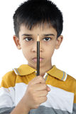 Indian little boy holding the pencil Royalty Free Stock Images