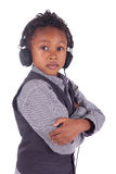 Indian little boy listening to music Royalty Free Stock Photography