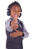 Indian little boy listening to music Stock Images