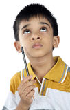 Indian little boy thinking Royalty Free Stock Images