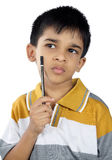 Indian little boy thinking Stock Image