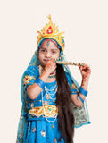 Indian little girl with flute Stock Photo