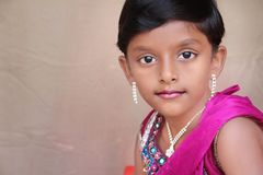 Indian Little Girl Posing to Camera Stock Photo