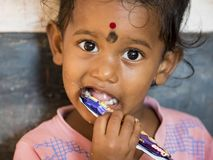 Indian little girl with shy timid expression royalty free stock photography