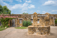 Indian Living Quarters Mission San Jose. Exterior wall of Mission San Jose in San Antonio, Texas, with living quarters for native American Indians and water well royalty free stock photography