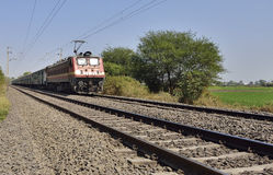 Indian Long Distance Train Approaching Station Royalty Free Stock Photography