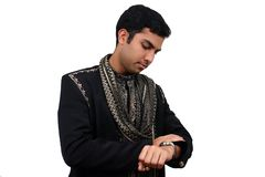Indian looking at the watch. Indian in traditional clothes loooking at the watch. Clipping path available Royalty Free Stock Photos