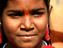Indian Looks. A beautiful Indian girl looking at something Stock Image