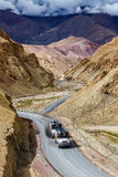 Indian lorry trucks on highway in Himalayas. Ladakh, India. Indian lorry cistern fuel tanker trucks on NH-1 (Srinagar Leh national highway) in Himalayas. Ladakh Royalty Free Stock Images