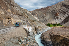 Indian lorry trucks on highway in Himalayas. Ladakh, India Stock Photo