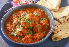 Indian meatballs kofta curry with roti flatbreads royalty free stock photography