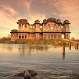 Indian luxury. Indian old palace near Ganges in the sunset Stock Images