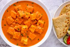 Indian Punjabi meal-Paneer butter masala and roti Royalty Free Stock Images