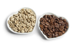 Indian Malabar green unroasted and brown roasted coffee beans Stock Photos