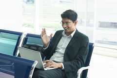 Indian male business man working from airport terminal Stock Images