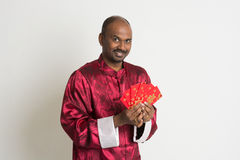 Indian male with chinese new year clothes Royalty Free Stock Images