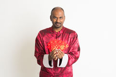 Indian male with chinese new year clothes Stock Image