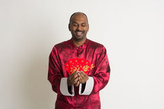 Indian male with chinese new year clothes Royalty Free Stock Photos