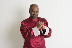 Indian male with chinese new year clothes Stock Photo