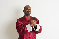 Indian male with chinese new year clothes Stock Images