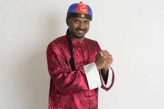 Indian male with chinese new year clothes Royalty Free Stock Photography