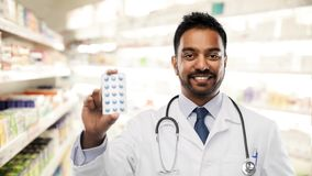 Free Indian Male Doctor Or Pharmacist With Pills Royalty Free Stock Images - 139078709