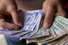 Indian Male Hand Counting Cash royalty free stock photos