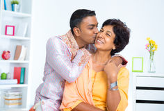 Indian male kissing his mother Royalty Free Stock Images
