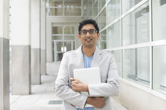 Indian male with laptop Royalty Free Stock Photography