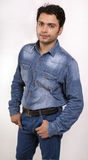 Indian male model in blue jeans Royalty Free Stock Image