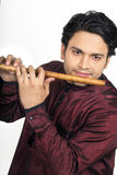 Indian male model playing flute Stock Photo