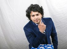 Indian male model wearing blue blazer. Closeup pose Royalty Free Stock Photos