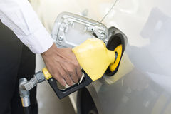 Indian male pumping fuel Stock Photo