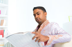 Indian male reading news paper Royalty Free Stock Photography