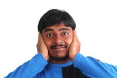 Indian male showing distress by covering his ears Stock Image