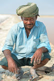 Indian male worker on salt farm Royalty Free Stock Image