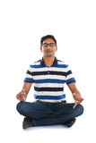 Indian male yoga post. On the floor Royalty Free Stock Images