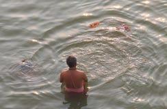 Ganges river ghat Varanasi India. Indian man bathes in Ganges river Varanasi India Royalty Free Stock Photography