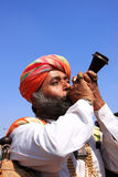 Indian man blowing horn during Mr Desert competition, Jaisalmer, India. Indian man blowing horn during Mr Desert competition, Jaisalmer, Rajasthan, India royalty free stock photography