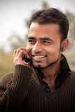 Indian man Busy on cell phone Royalty Free Stock Photos