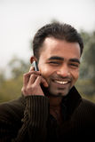 Indian man Busy on cell phone Stock Photos