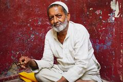 An Indian man with calm expression
