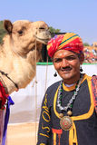 Indian man with a camel taking part in Desert Festival, Jaisalme Stock Image
