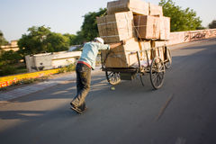 Indian Man Carrying Boxes On Hand Cart Stock Image