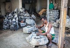 Indian man carving stone statue Stock Images