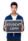 Indian man with chalkboard showing a phrases of student loan Stock Photo