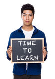 Indian man with chalkboard showing the phrases of time to learn. Isolated on white background Stock Photos