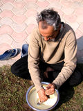 Indian Man Churning Butter Royalty Free Stock Images
