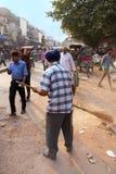 Indian man cleaning street after Guru Nanak Gurpurab celebration Stock Photos